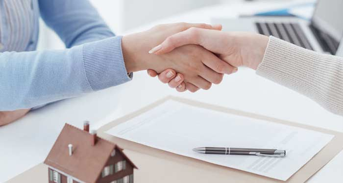 Shaking hands with Loan Officer